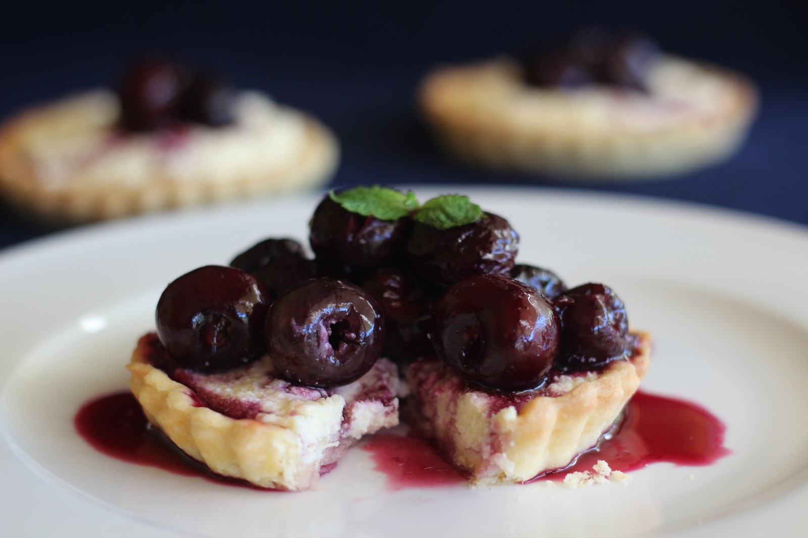 White Chocolate Tart with Cherries in Red Wine Sauce