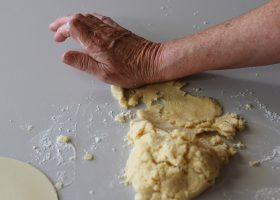 Push small sections of the dough away from you using heel of hand