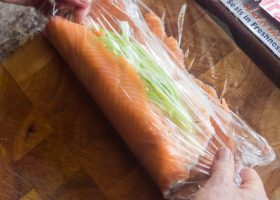 Begin to roll up the salmon