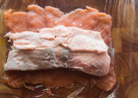 Place fresh salmon layer on top
